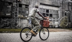 A local fisherman uses his bike to get around Mobile with his catch.